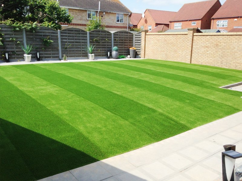A striped lawn with artificial grass